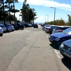 Parking lot of Praia Formosa with cars