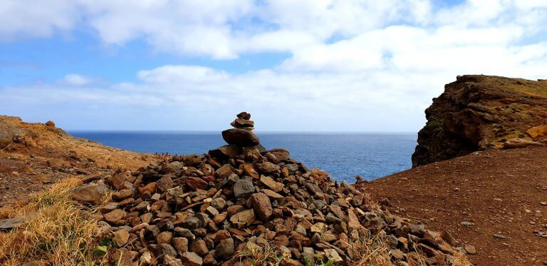 Little stone building with the ocean in the back in Peninsula Sao Lourenco